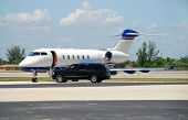 picture of luxury cars  - Luxury private jet parked and waiting for celebrity client - JPG