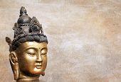 serene buddha head on textured background