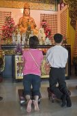 Asian Praying