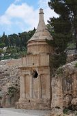 Ancient Tomb of Absalom in Jerusalem with two birds on top