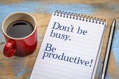 Dont be busy. Be productive. Handwriting in a spiral notebook with a cup of coffee. poster