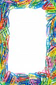 Colorful Paper Clips Frame With Isolated Space For Text