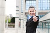 Businesswoman Winking And Giving Thumbs Up