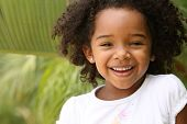 stock photo of cute little girl  - Cute little girl having fun in a park - JPG