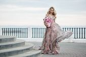 Beautiful Woman In Elegant Evening Dress. Blonde Girl With Long Healthy And Curly Hair. Beautiful Yo poster
