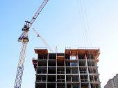 Construction Site Background. Self-erection Crane Over Construction Site poster
