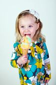 little blond girl eating ice cream cone