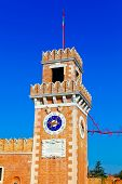 stock photo of arsenal  - Tower near of entrance of Venetian Arsenal with big clocks Venice Italy - JPG