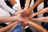 High Angle View Of Multiracial Friend Stacking Hand Together poster