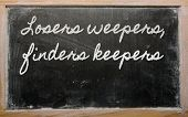 Expression -  Losers Weepers, Finders Keepers - Written On A School Blackboard With Chalk