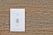 House Electric Light Switch In On Position On Wood