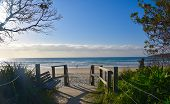 Old Wooden Walkway Path Entrance To The Beach. Sandy Ocean Beach Entrance. Sea Beach Wooden Walkway  poster