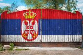 Close-up Of The National Flag Of Serbia On A Wooden Gate At The Entrance To The Closed Territory On  poster