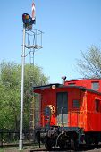 image of caboose  - The traditional red caboose at the end of the train.