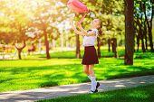 Portrait Of Happy Caucasian Young Smiling Girl Wearing School Backpack Outside The Primary School. S poster