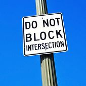 do not block intersection sign over the blue sky