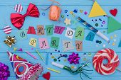 Happy Birthday Background With Party Supplies. Birthday Decor On Blue Wooden Background. Birthday De poster