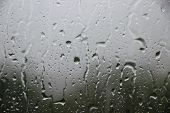 Window With Large Drops Of Rain On A Gray Background. The First Summer Storm. Rain Drops On A Window poster