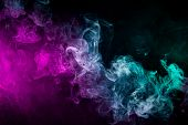Dense Multicolored Smoke Of   Blue And Purple Colors On A Black Isolated Background. Background Of S poster