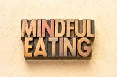 mindful eating  - word abstract in vintage letterpress wood type printing blocks poster