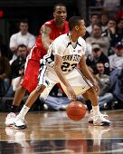 Ohio State guard William Bufford #44 defends Penn State's #23 Tim Frazier
