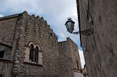 Retro street lantern in Medieval center of Taormina Italy on cloudy day