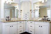 stock photo of bath tub  - Luxury large white master bathroom cabinets with double sinks - JPG