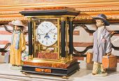 Clock And Ceramic Dolls