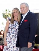 LOS ANGELES - FEB 22:  JENNIFER ANISTON & her dad, JOHN ANISTON arriving to Walk of Fame Ceremony for Jennifer Aniston  on February 22, 2012 in Hollywood, CA