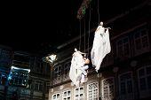 GUIMARAES, PORTUGAL - December 22: La Fura dels Baus performs aerial acrobatic show during the European capital of culture closure on December 22, 2012 in GUIMARAES, PORTUGAL.
