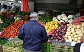 picture of farmers market vegetables  - jewish man at vegetables stalll Haifa Israel - JPG