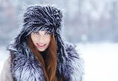 a beauty girl on the winter background
