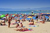 SALOU, SPAIN - AUGUST 10: Vacationers in Llevant Beach on August 10, 2012 in Salou, Spain. Salou is