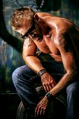 pic of garage  - Portrait of a handsome muscular man in the old garage - JPG