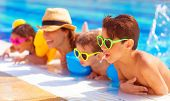 Happy family in the pool, having fun in the water, mother with three kids enjoying aquapark, beach r