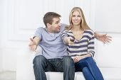 young caucasian couple sitting on couch