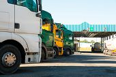 foto of trucking  - Lorry trucks cars in traffic jam at border zone custom - JPG