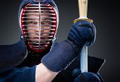 Close up of kendo fighter with shinai. Japanese martial art of sword fighting