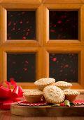 Christmas mince pies against festive window