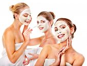 stock photo of mud  - Group women with  facial mask in beauty spa - JPG