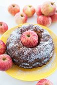 Kugelhopf Apple Cake On  Yellow Plate With Red Apples Around