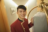 Bellhop smiling, portrait