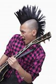 pic of half-shaved hairstyle  - Young man with punk Mohawk playing guitar - JPG