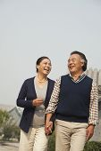 Senior couple going for a stroll in Beijing, holding hands