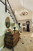 image of entryway  - Hallway foyer with dresser and grandfather clock - JPG