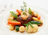 Tenderloin steak with steam fried vegetables and cooked bone marrow