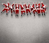 Christmas Santa hanging on rope. Funny concept background.