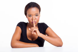 stock photo of shhh  - african american woman saying shhh isolated on white background - JPG
