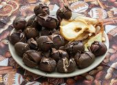 Pile Of A Delicious Roasted Chestnuts And Dried Sliced Apples