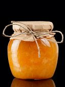 foto of jar jelly  - Orange jelly in glass jar isolated on black background - JPG